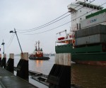 Tugs were tied stern first to help stop some freighters going into the locks