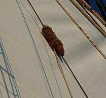 Baggywrinkle on the Schooner Adventuress. Baggywrinkle is a traditional anti-chafing method.