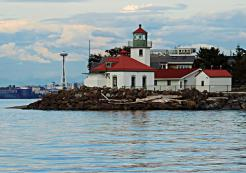 Alki Point Lighthouse, West Seattle, Washington with the Space Needle in down town Seattle in the background
