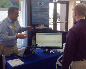 Navigation manager Kyle Ward explains some of Coast Survey's new products at the Savannah Boat Show.