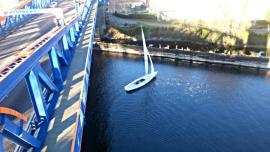 Sorry sir, per the CFR's the Fremont Bridge will not open for a sailboat that is not using auxiliary power